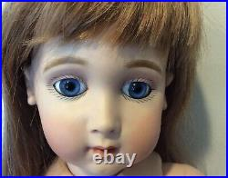 25 Antique Reproduction of a Long Face Jumeau with Blue Glass Paperweight Eyes